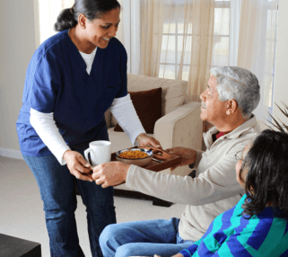 caregiver assisting her old patients